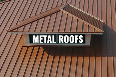 """A commercial building in Ft. Myers, FL with an orange metal roof with the caption, """"Metal Roofs"""""""